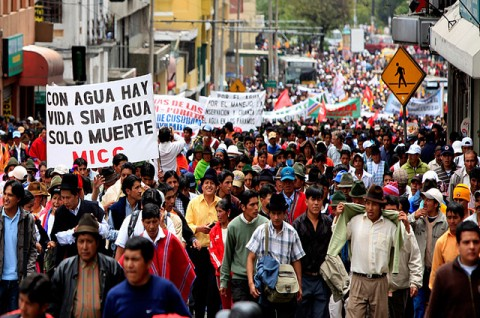 Some 6,000 indigenous people take part in a protest against a polemic government bill on water resource